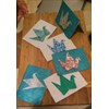 Origami cranes, the symbol of hope, on handmade paper greeting cards.